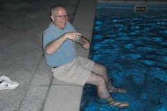 Greg relaxing poolside after a busy day