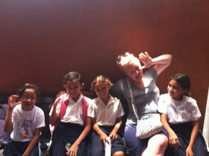 Morgan making funny faces with some Nica kids.