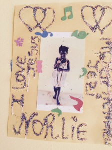 Norlie's glitter photo collage.