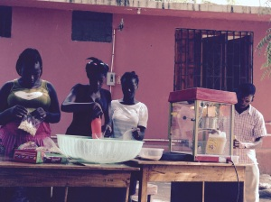 Herve and local girls making popcorn for 'Movie Night'.