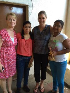 Team members with two of the vocational students
